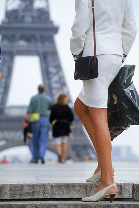 Lady with shopping bag and passing couple at Palais de Chaillot in Trocadero with Eiffel Tower