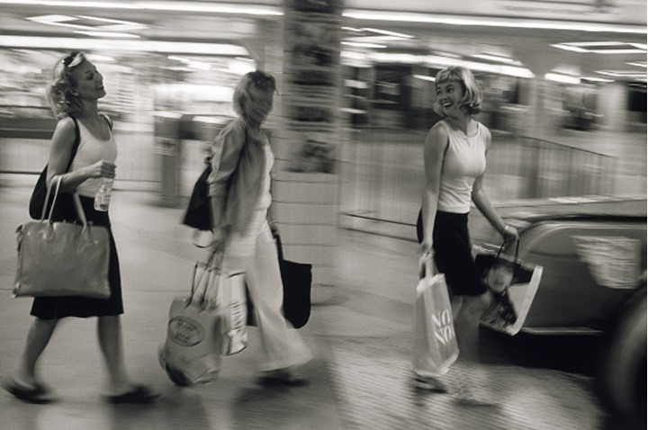 Three women with shopping bags at metro station in Stockholm