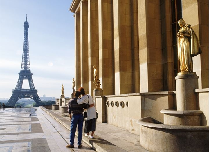Couple at Palais Chaillot with Golden Figurines and Eiffel Tower