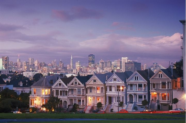 Victorian houses on Steiner Street at dusk in San Francisco