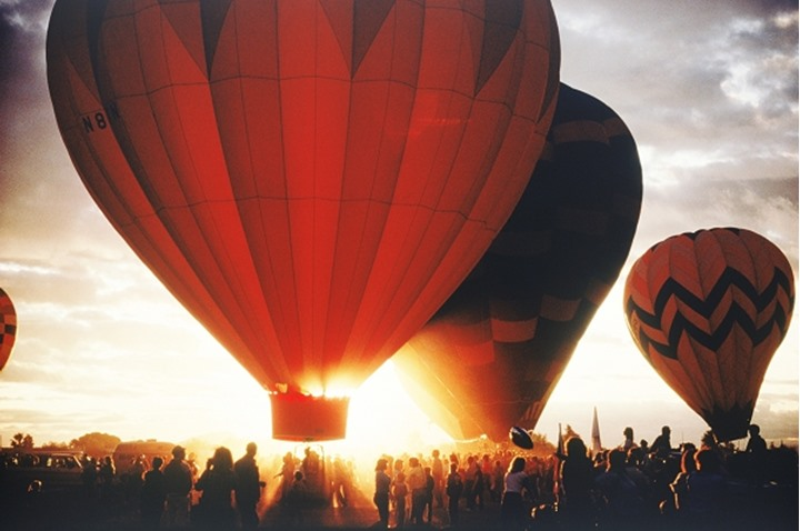 Balloons lifting off at sunrise in Albuquerque