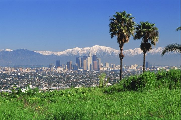 Snow covered San Gabriel Mountains behind downtown Los Angeles skyline
