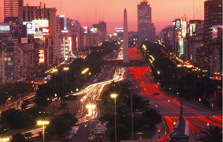 Avenida 9 de Julio at dusk in Buenos Aires with Obelisk and traffic