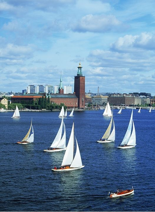 Sailboat Day in Stockholm on Riddarfjarden with City Hall beyond