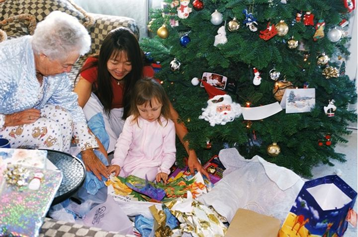 Three generations sharing presents on Christmas morning