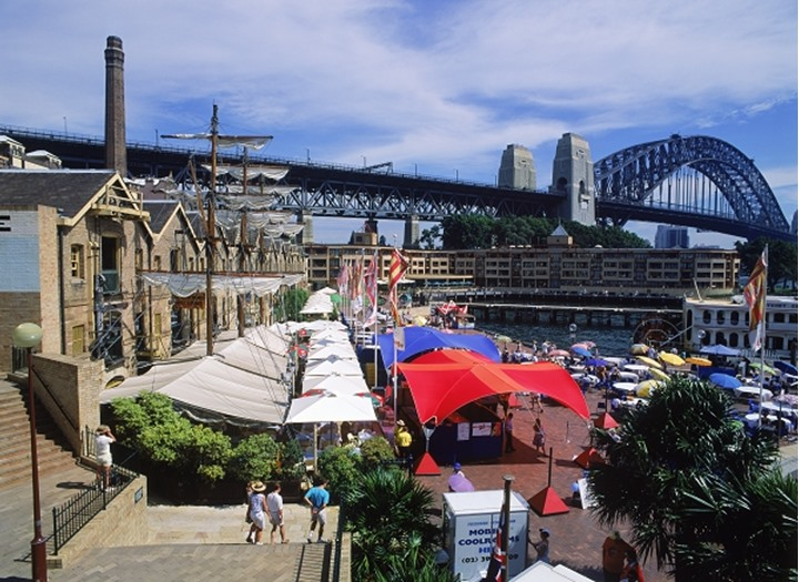 The Rocks area of Sydney with resturants and Harbor Bridge