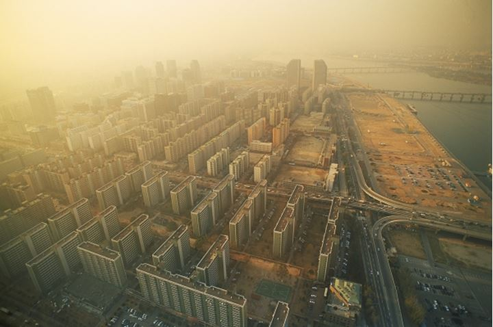 City smog at sunset over Han River highrise apartments in Seoul South Korea