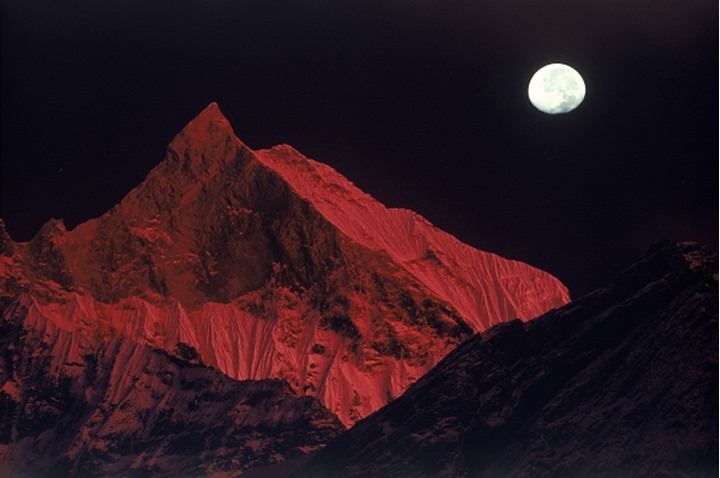 Himalayan Macchapuchhre Peak in Nepal painted fire red at sunset
