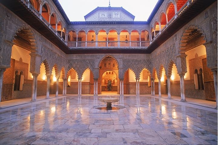 Almohad-Gothic style rooms and courtyards of Alcazar Palace in Seville