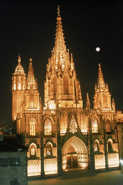 The Cathedral at night under full moon in Barcelona Spain