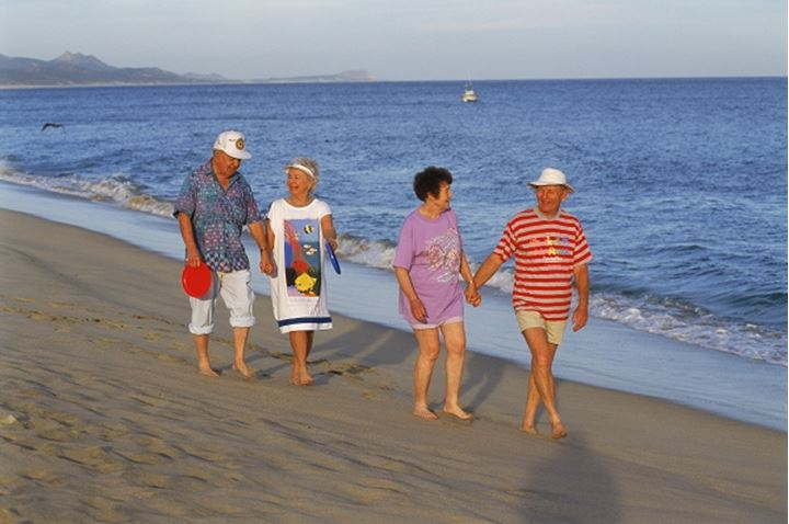 Elderly couples walking on beach at San Jose del Cabo in Baja California