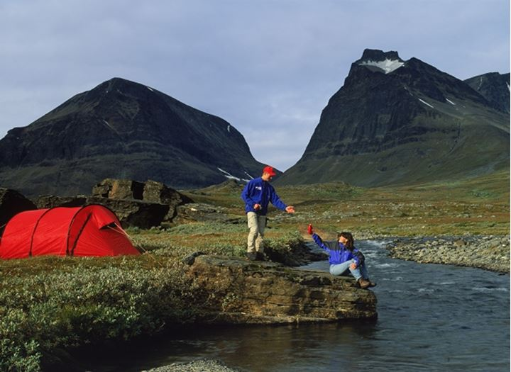 Couple camping and hiking in Swedens Arctic wilderness near Mount Kebnekaise