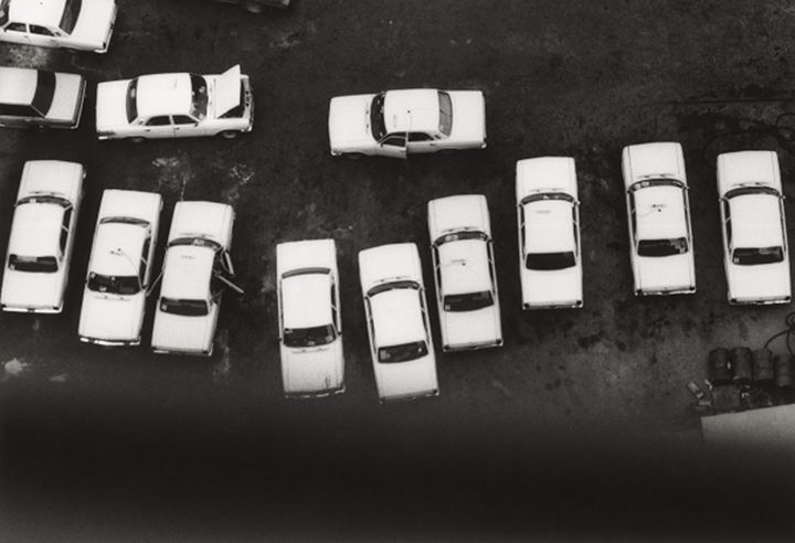 White cars on a parking lot, China