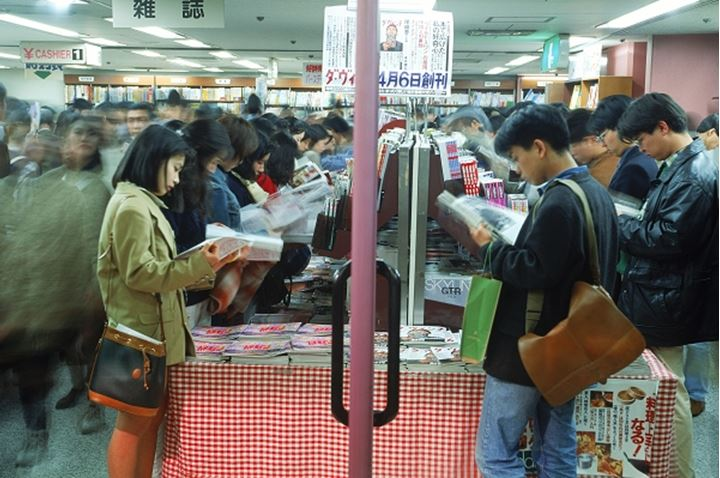 People browsing through magazines in Tokyo bookstore