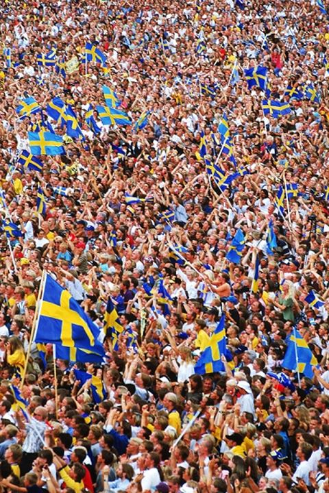 Swedish people waving flags after football victory in World Cup