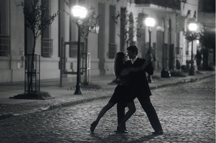 Couple dancing by lamplight on San Telmo street in Buenos Aires