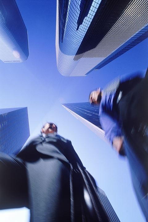 Business partners moving through Los Angeles skyscrapers