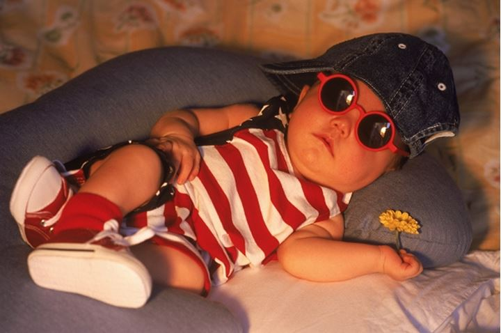 Baby sleeping in outfit that says made in America