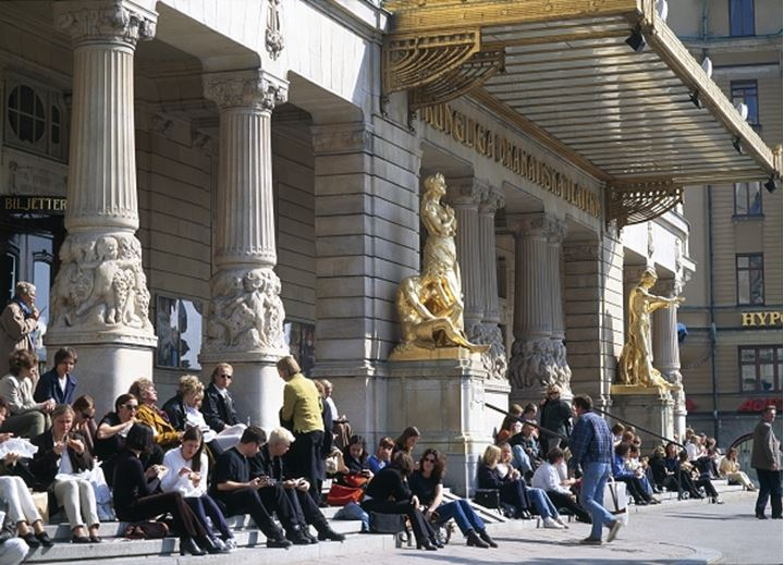 People sitting outside of Dramaten, theatre in Stockholm, Sweden