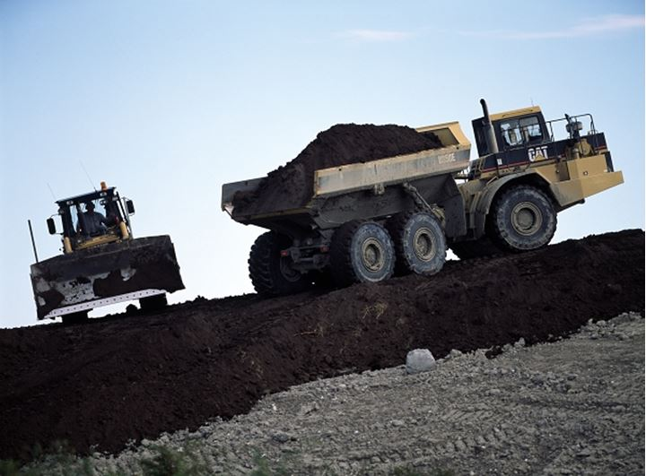 Bulldozer and a dump truck at a construction site