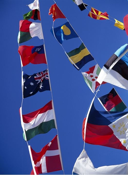 Flags of different countries hanging on a boat