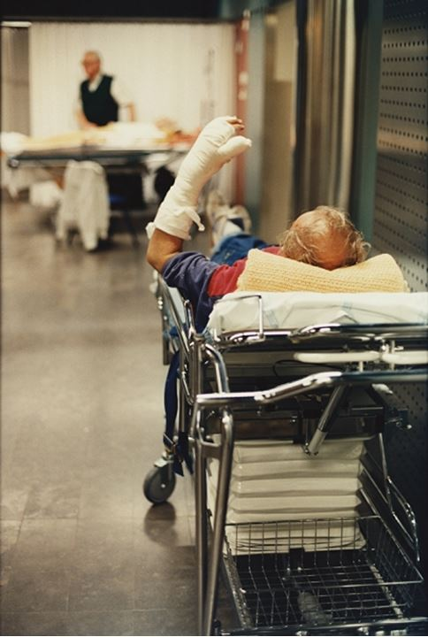 A man with a plastered arm in a hospital