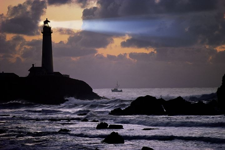 Pigeon Point Lighthouse with fishing boat at Pescadero California