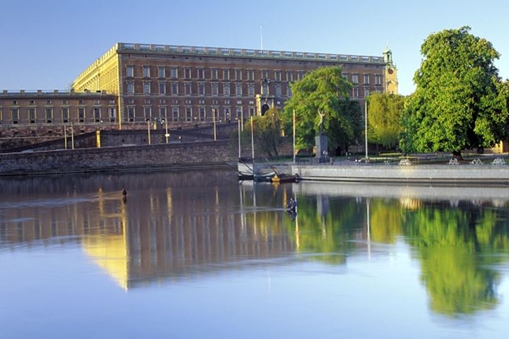 Fishing for salmon near the Royal Palace at sunrise in Stockholm