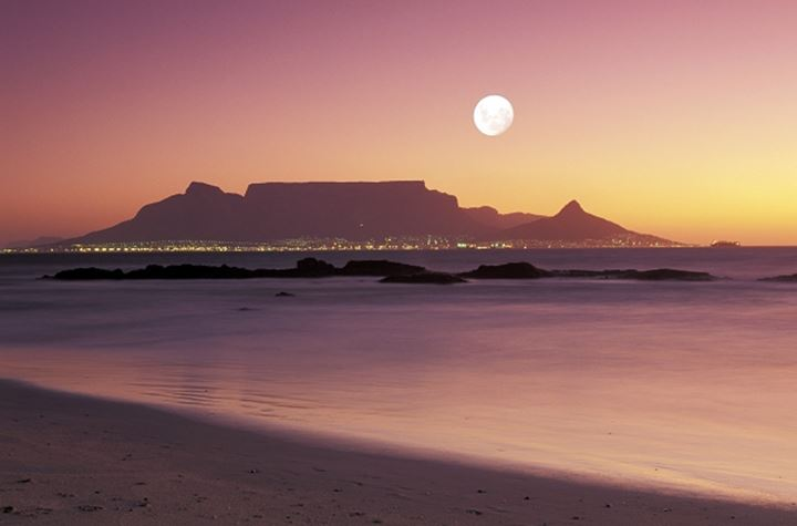 Moon over Table Mountain in Cape Town from Bloubergstrand