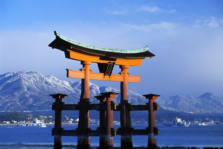 Torii Gate at Miyajima with snow covered mountains