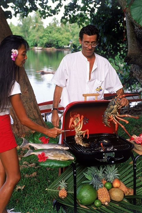 Barbequeing fresh lobster and fish in South Pacific