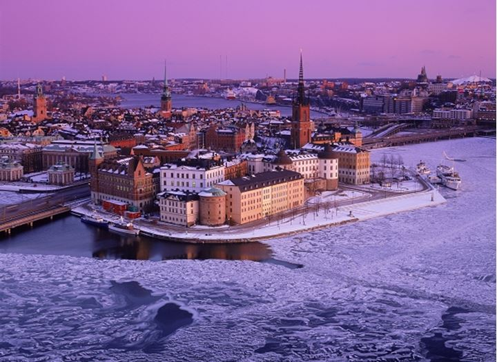 Riddarholmen and Old Town in Stockholm under crimson winter skies