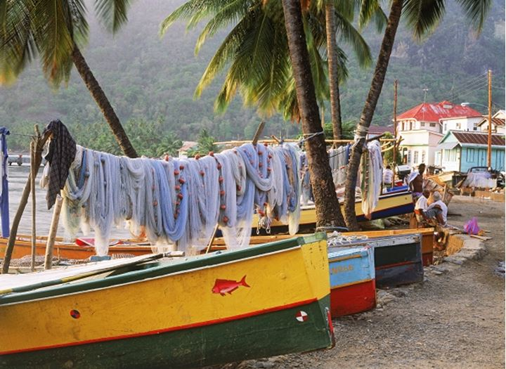 Fishing boats and nets at Soufriere village on St Lucia in West Indies