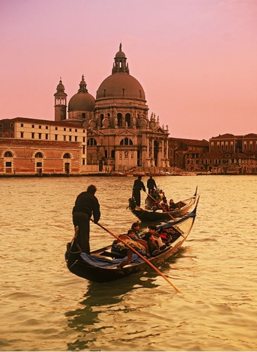 Gondola with Santa Maria dell Salute in Venice at sunset