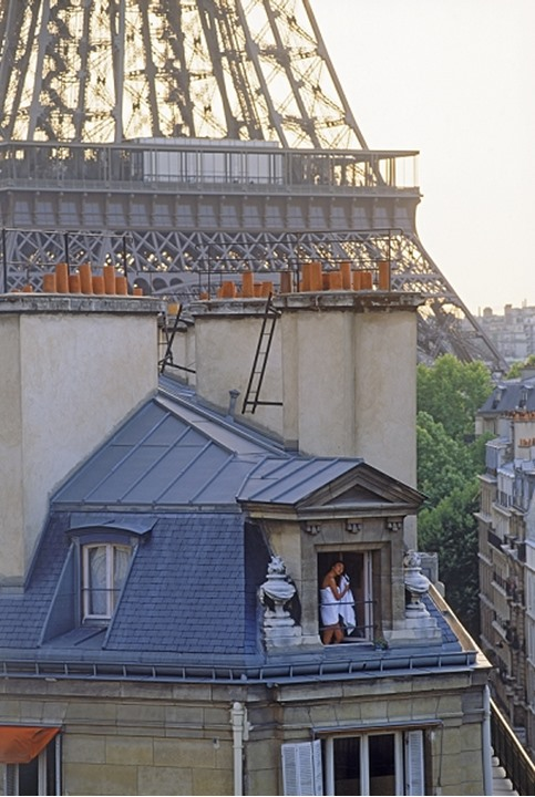 Women in Paris apartment drying hair after shower