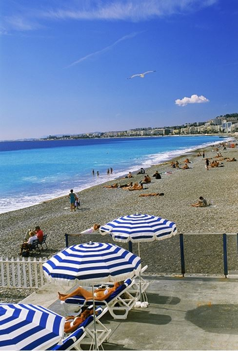 Umbrellas on Promenade des Anglais in Nice on Cote d Azur in France