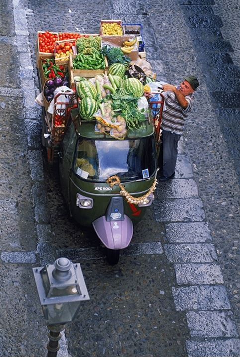 Vegetable delivery truck on village streets of Cefalu in Sicily