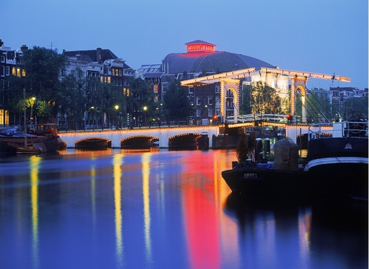 Magere Bridge over Amstel Canal in Amsterdam at night