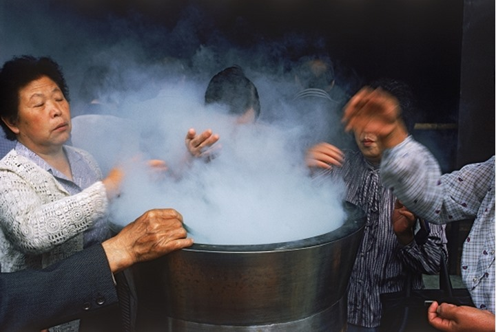 Bathing in incense at Asakusa Temple from 7th Century in Tokyo