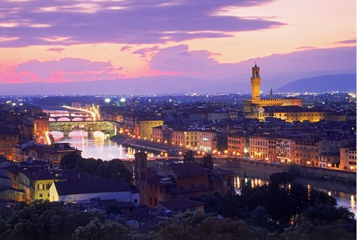 Ponte Vecchio Duomo cathedral on Arno River at sunset in Florence