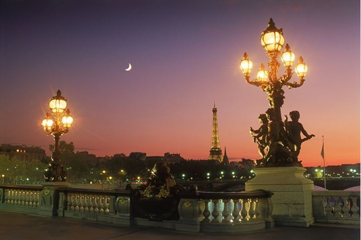Pont Alexandre III with Eiffel Tower and cresent moon at dusk
