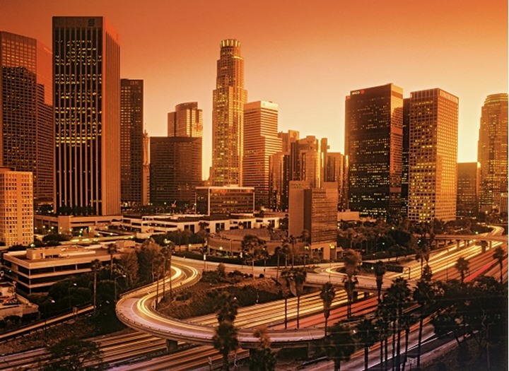 Downtown Los Angeles with passing freeways at dusk