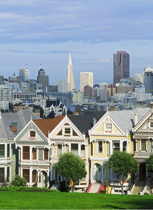 Victorian Houses on Steiner Street in San Francisco with skyline
