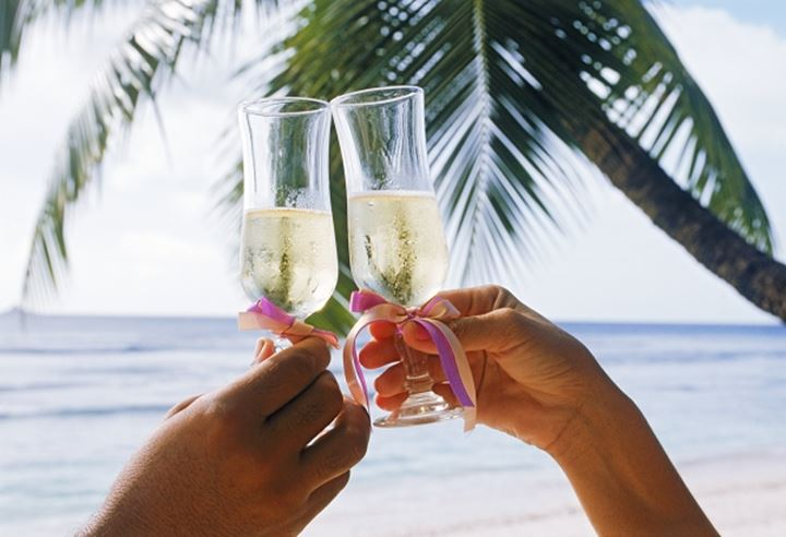 Two people toasting a lovely island holiday