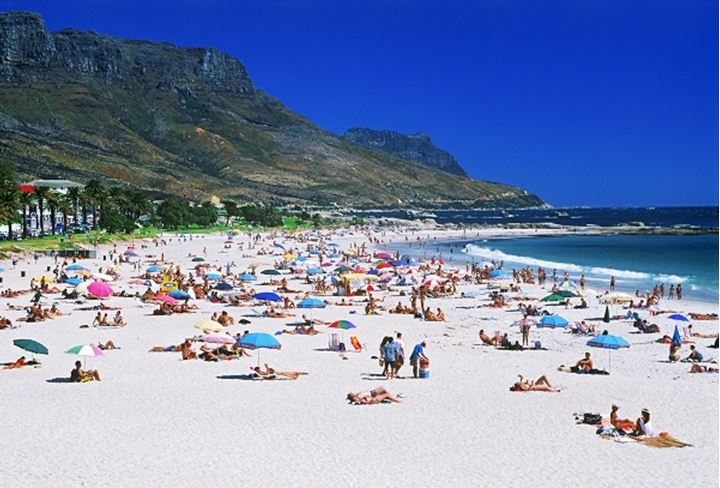 Sunbathers at Camps Bay below Table Mountain in Cape Town on Western Cape of South Africa