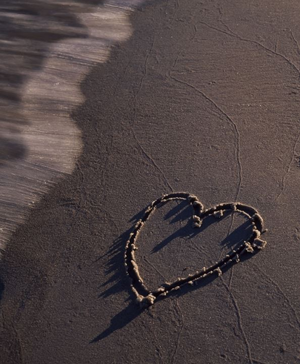 Close-up of a heart shape on the beach