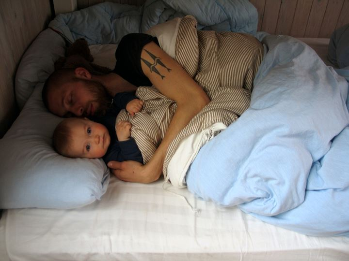 Father and son lying in bed
