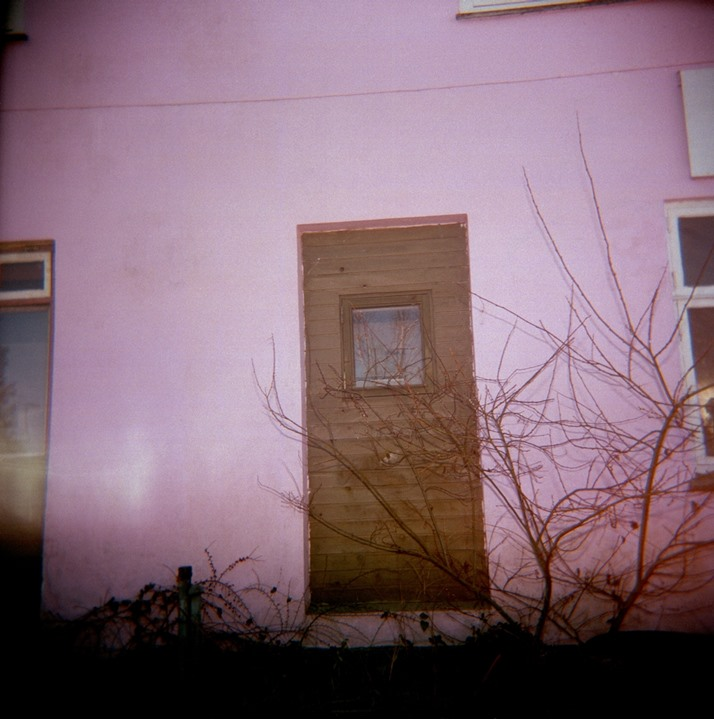 Door in pink wall