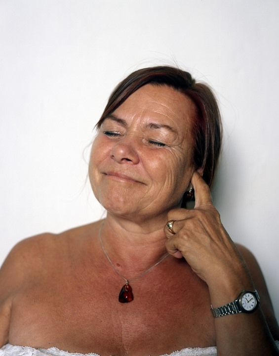Mature woman clawing in her ear