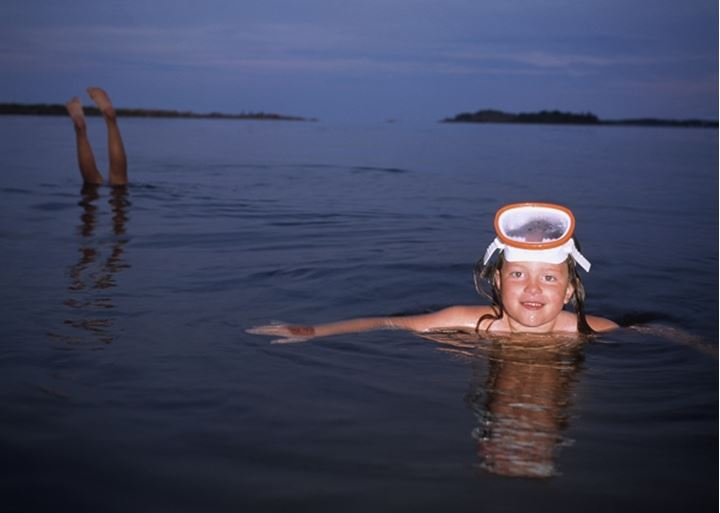 Portrait of a girl swimming in the sea. Sweden